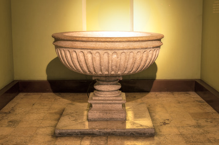 baptismal: Illuminated stone baptismal font in Cathedral of Ildefonso in Merida, Mexico