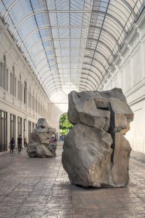 merida: MERIDA, MEXICO - JANUARY 19, 2015: Works of art in stone are on display in Pasaje Revolucion featuring Jorge Yazpik