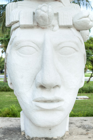 representations: Statue of the head of Pakal, the Maya king who reigned the city of Palenque in the 7th century, is situated between lanes of the Hotel Zone in Cancun
