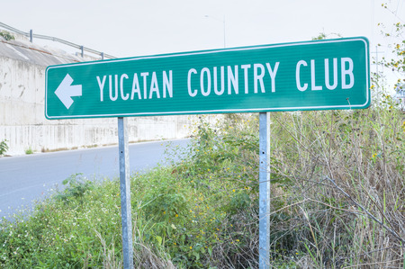 Highway sign indicates direction to Yucatan Country Club north of Merida, Mexico