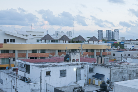 reveals: CANCUN, MEXICO - JANUARY 22, 2015: A rooftop view  at sunrise reveals the urban development of the city of Cancun in the early morning light Editorial