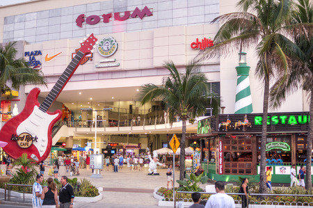 roo: CANCUN, MEXICO - JANUARY 22, 2015: The Forum in the Cancun hotel zone is a popular place for tourists to enjoy modern shopping, restaurants, bars, nightclubs, and people watching