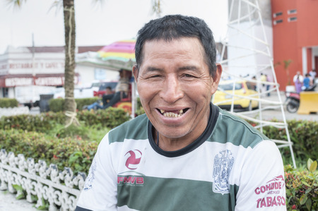 evident: PICHUCALCO, MEXICO - DECEMBER 21, 2014: Tooth decay is a serious and common problem among the indiigenous populations in Mexico, as is evident in the smile of this indigenous man