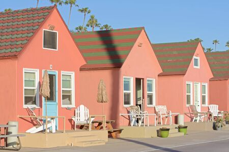 rentals: OCEANSIDE, USA - APRIL 27, 2015: Cute pastel-colored beach themed cottages are available as vacation rentals along the almost always sunny coast in Oceanside, California.