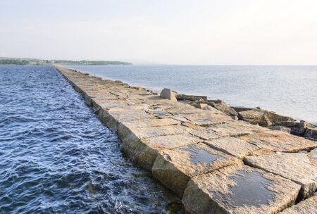 seperation: Rocky breakwater jetty extends for seveneighths of a mile from shore to middle of bay in Rockland Maine