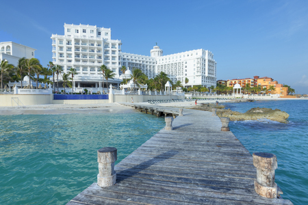 accommodations: CANCUN, MEXICO - JULY 30, 2015:  Seaside resorts such as Hotel Riu Palace continue to offer quality five-star accommodations along the beautiful Caribbean coastline of Cancuns hotel zone