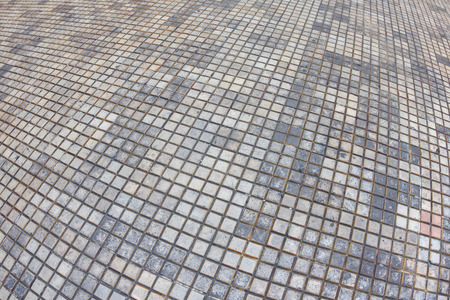 merida: Wide angle fisheye view of outdoor patio floor consisting of different tones of small square tiles in Merida, Mexico Stock Photo