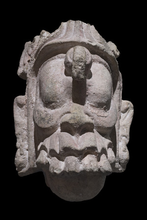 supernatural: Closeup stone Mayan sculpture of head of supernatural being from Copan, Honduras isolated on black background Stock Photo