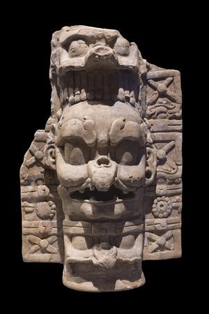 hideous: Frightening depiction of Kawiil, the Lightning God, on a ceramic Mayan incense burner base isolated on black background