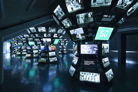 municipal editorial: SAO PAULO, BRAZIL - SEPTEMBER 23, 2015: Columns of monitors display historical moments in the history of football soccer at the Museum of Football at Estdio Municipal Paulo Machado de Carvalho in Sao Paulo, Brazil