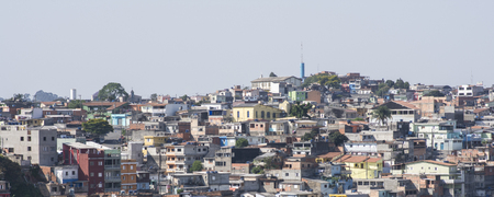 concrete structure: SAO PAULO, BRAZIL - SEPTEMBER 23, 2015: Concrete homes sprawl up residential hillside in Brazilian favela in Sao Paulo Editorial