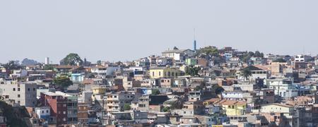 urban sprawl: SAO PAULO, BRAZIL - SEPTEMBER 23, 2015: Concrete homes sprawl up residential hillside in Brazilian favela in Sao Paulo Editorial