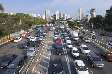 traffic building: SAO PAULO, BRAZIL - SEPTEMBER 25, 2015: Commuters battle heavy traffic congestion on Avenida 23 de Maio Avenue 23 of May during afternoon rush hour in Sao Paulo, Brazil