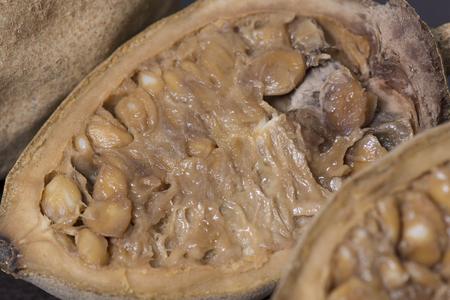 americana: Macro closeup raw Genipa americana jenipapo fruit cut in half