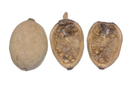 americana: Closeup whole and cross section Genipa americana jenipapo fruit isolated on white background