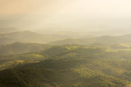 diffused: Hazy diffused sunlight illuminating beautiful hilly landscape west of Serra da Moeda in Minas Gerais, Brazil Stock Photo