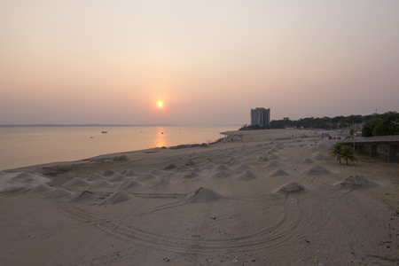 mounds: Mounds of beach sand along Rio Negro river at Ponta Negra near Manaus in the Amazon during beautiful sunset