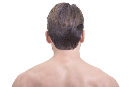 Smooth hairless skin upper back and neck of well groomed Caucasian man on white background