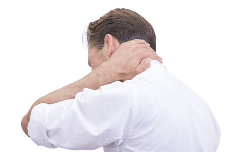 man back pain: Rear side angle of Caucasian man in white business shirt with rolled up sleeves massaging painful sore neck on white background Stock Photo