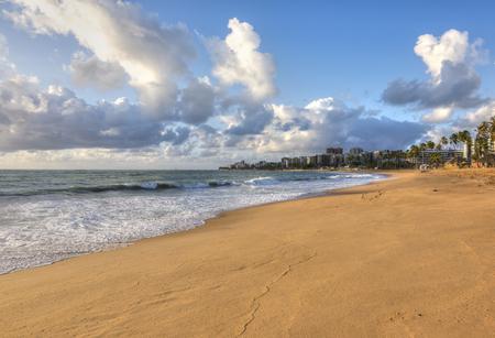 northeast: Morning light bathes tan-colored sandy beach in Maceio, Alagoas, Brazil