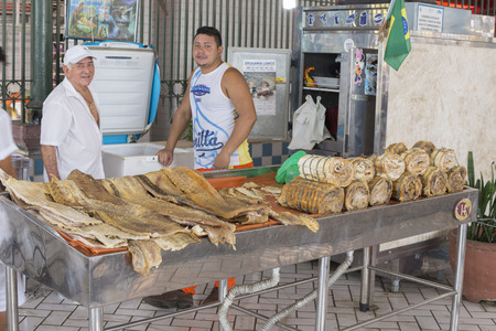 municipal editorial: MANAUS, BRAZIL - OCTOBER 17, 2015: Large fillets of salted dried fish caught in the Amazon are sold at a market stall in the Mercado Adolfo Lisboa in Manaus, Amazonas, Brazil Editorial