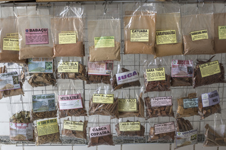 municipal editorial: MANAUS, BRAZIL - OCTOBER 17, 2015: Natural herbal remedies are a popular alternative medicine in Brazil.  Dozens of packaged herbal products can be found for sale at the Municipal Market in Manaus. Editorial