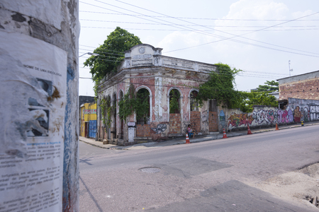 deteriorated: MANAUS, BRAZIL - OCTOBER 18, 2015: Manaus, once a very wealthy city, today has many heavily deteriorated buildings and almost totally abandoned neighborhoods.