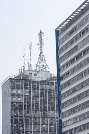 antennas: MANAUS, BRAZIL - OCTOBER 18, 2015: Tall residential high rise apartment complexes are a common sight in major Brazilian cities such as these in Manaus, Amazonas.