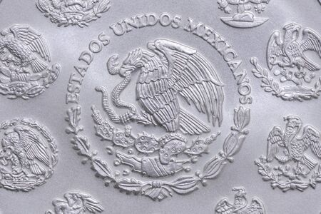 coin silver: Macro closeup of coat of arms of Mexico on reverse side of Mexican silver bullion libertad coin