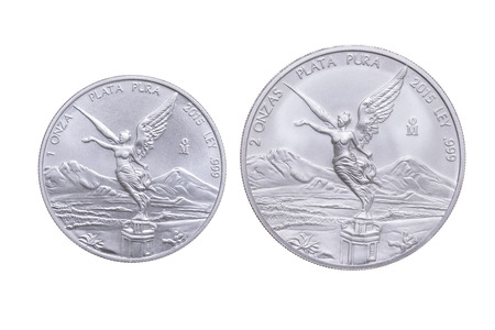 ounce: Side by side size comparison between one ounce and two ounce Mexican silver bullion libertad coins isolated on white background