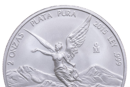 silver bullion: Macro closeup top half of front side of Mexican pure bullion silver libertad coin on white background Stock Photo