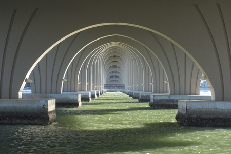 Diminishing perspective of support arches under highway 682 bridge connecting Isla del Sol and St. Pete Beach in Florida