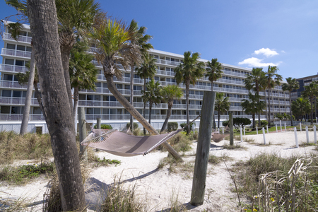 pinellas: ST. PETE BEACH, FLORIDA, USA - FEBRUARY 25, 2016: Tradewinds Island Grand Resort on St. Pete Beach sits on the gulf side with white sandy beaches and hammocks between palm trees. Editorial