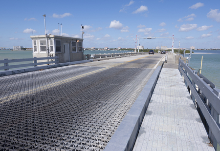 tenders: ST. PETERSBURG, FLORIDA, USA - FEBRUARY 25, 2016: The bridge tenders house sits at the top of the arch of the Tierra Verde drawbridge constructed in 1962 as a connection between Tierra Verde island and the mainland of St. Petersburg. Editorial