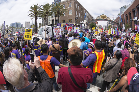 protest signs: SAN DIEGO, USA - MAY 27, 2016: The anti-Trump demonstration in San Diego attracts hundreds of protesters to speak their voice outside a Trump rally at the convention center.