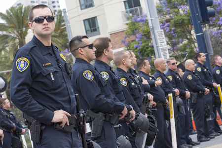 SAN DIEGO, USA - MAY 27, 2016: San Diego police officers stand on watch in an effort to keep the peace at an anti-Trump demonstration outside a Trump rally at the San Diego Convention Center.