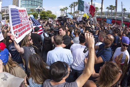 media center: SAN DIEGO, USA - MAY 27, 2016: Media cameras frantically capture the action as anti-Trump protesters meet Trump supporters outside a Donald Trump rally at the San Diego Convention Center.