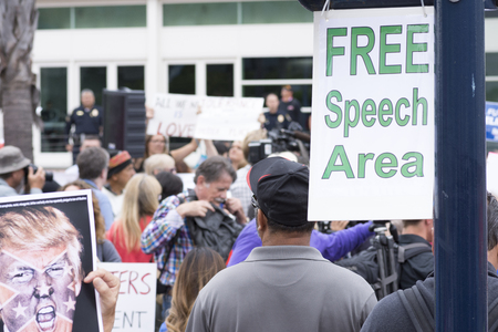 free speech: SAN DIEGO, USA - MAY 27, 2016: A sign marks the designated free speech area at a protest outside a Trump rally held at the San Diego Convention Center. Editorial