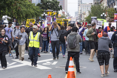 marched: SAN DIEGO, USA - MAY 27, 2016: The Trump rally in San Diego was met by a huge opposition crowd that marched the streets of downtown to meet Trump supporters outside the convention center.