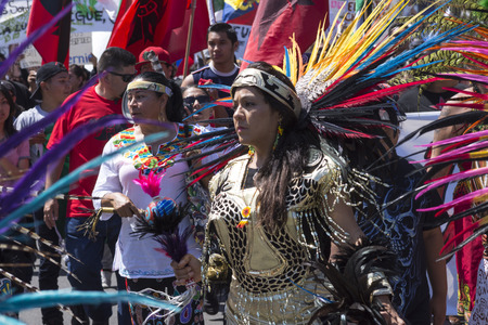 oppose: SAN DIEGO, USA - MAY 27, 2016: The Trump rally in San Diego draws a diverse crowd of protesters including some that march in opposition while dressed in traditional native American costumes.