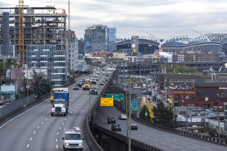 settling: SEATTLE, USA - JUNE 15, 2016: State Route 99 runs along the Seattle seaboard as a double-decked highway system known as the Alaskan Way Viaduct. A project is currently underway to replace the settling viaduct with a tunnel.