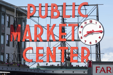 pike place market sign: SEATTLE, USA - JUNE 15, 2016: The bright red public market sign marks the main entrance to Seattles famous Pike Place Market.