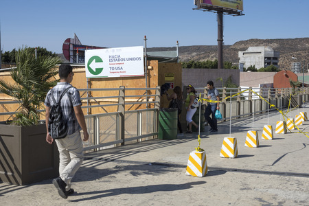 new entry: TIJUANA, MEXICO - AUGUST 20, 2016: During construction a temporary access is open from the Tijuana River pedestrian bridge to the new San Ysidro Port of Entry known as PedWest. Editorial