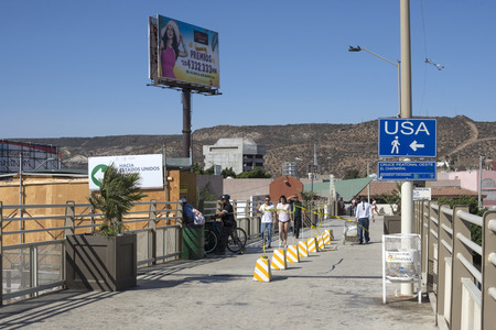 TIJUANA, MEXICO - AUGUST 20, 2016: Travelers returning from Tijuana can now use the temporary walkway to the new San Ysidro port of entry PedWest facility when going to the United States.