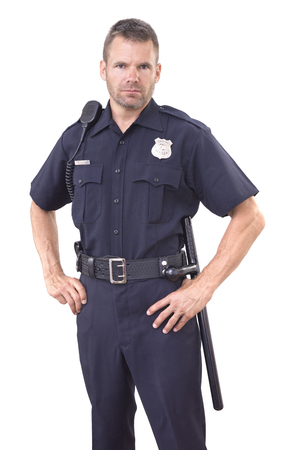 Handsome Caucasian police officer wearing cop uniform stands with authority and bold eyes on white background Banque d'images