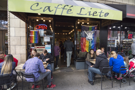 locals: SEATTLE, USA - JUNE 11, 2016: Caffe LIeto shares its space with another small cafe specializing in biscuits. Together they are a very popular spot for locals and tourists alike.