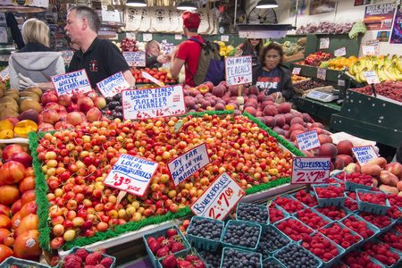 pike place: SEATTLE, USA - JUNE 11, 2016: High quality fresh fruits including local favorites Rainier cherries and blueberries are available at many fruit stands at the famous Pike Place Market.