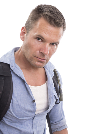 Closeup portrait of handsome Caucasian man wearing backpack and camelback with blue shirt looking boldly into camera with look of determination on white background