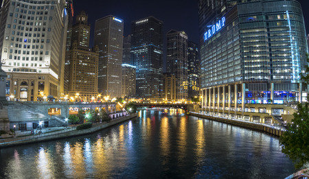 downtown district: CHICAGO, USA - JUNE 4, 2016: The Chciago River runs through downtown Chicago dividing the business district on the left from the River North Gallery District on the right. Breathtaking views can especially be had at night. Editorial