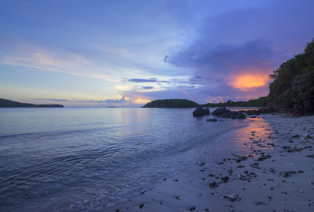 tranquil: HDR image of bright orange cloud at sunset over Tamarindo Grande beach on idyllic Caribbean island of Isla Culebra Stock Photo